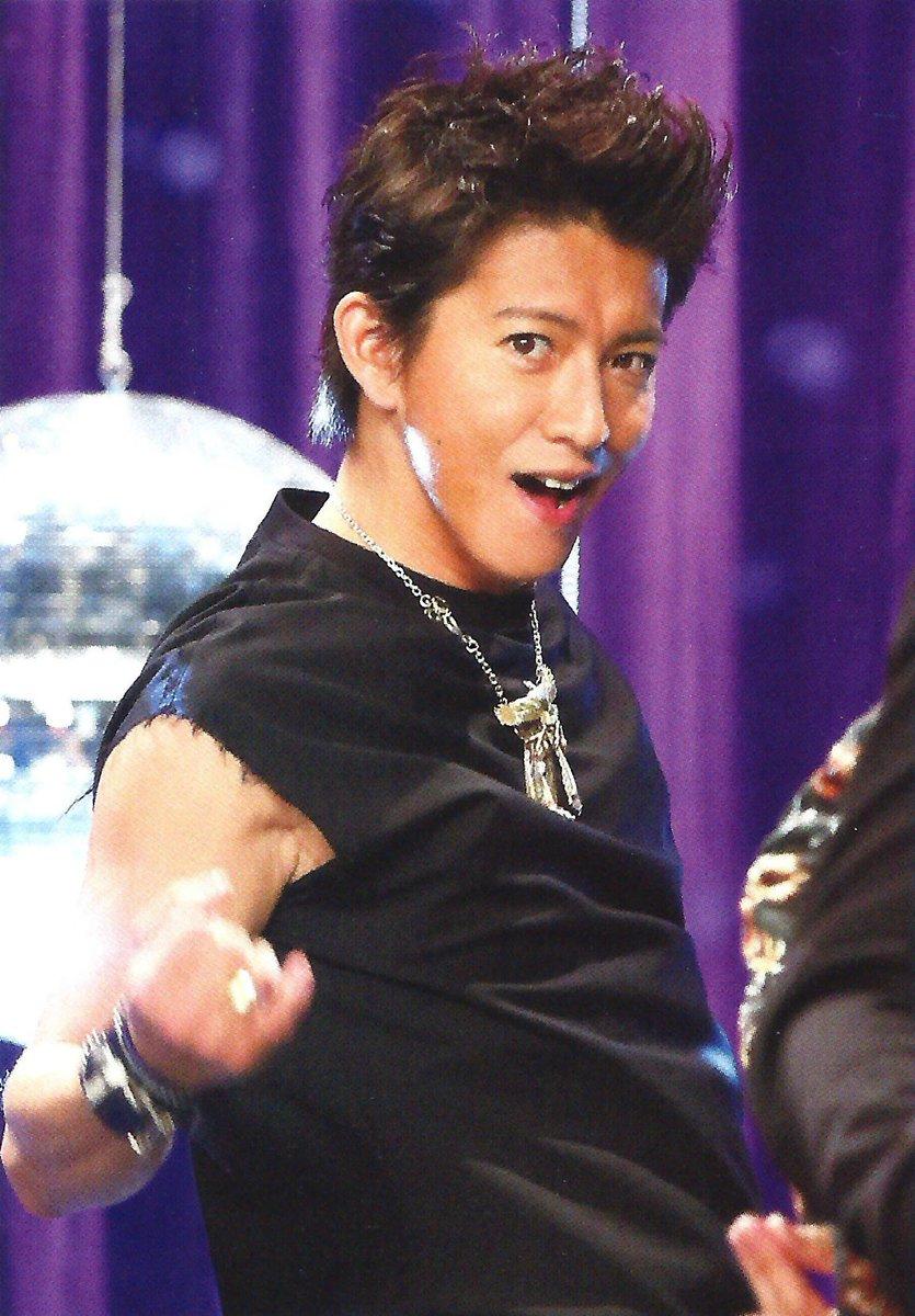 ノリノリで踊って歌うアイドルの顔の木村拓哉