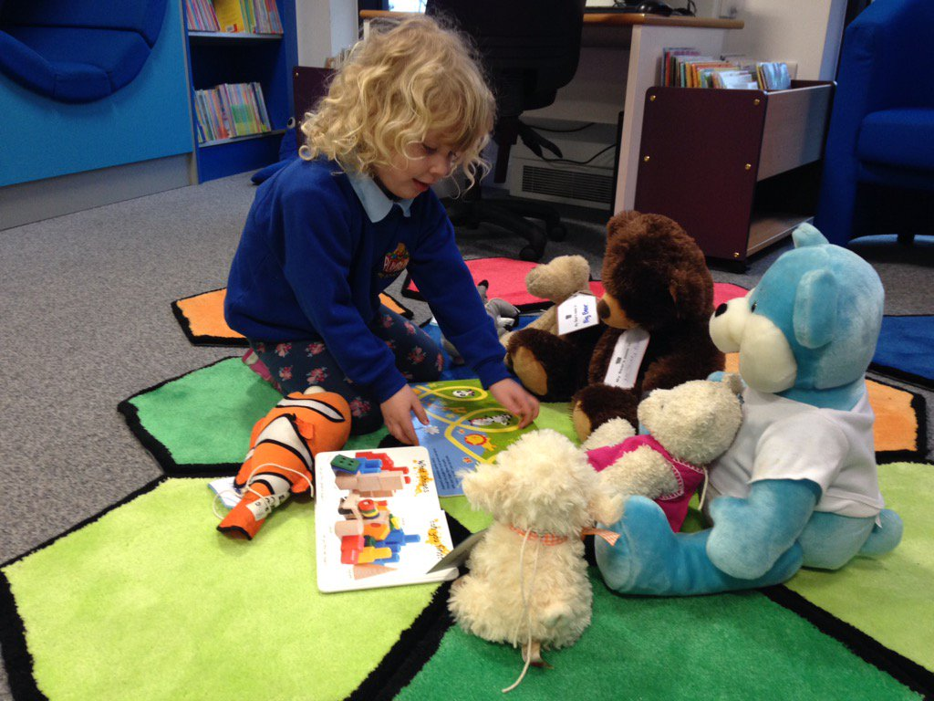 Jessica is reading a bedtime story to the teddies. #librariesday https://t.co/83WnzsZhgL