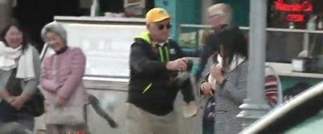 WHY is this tourist grabbing a pigeon?!?