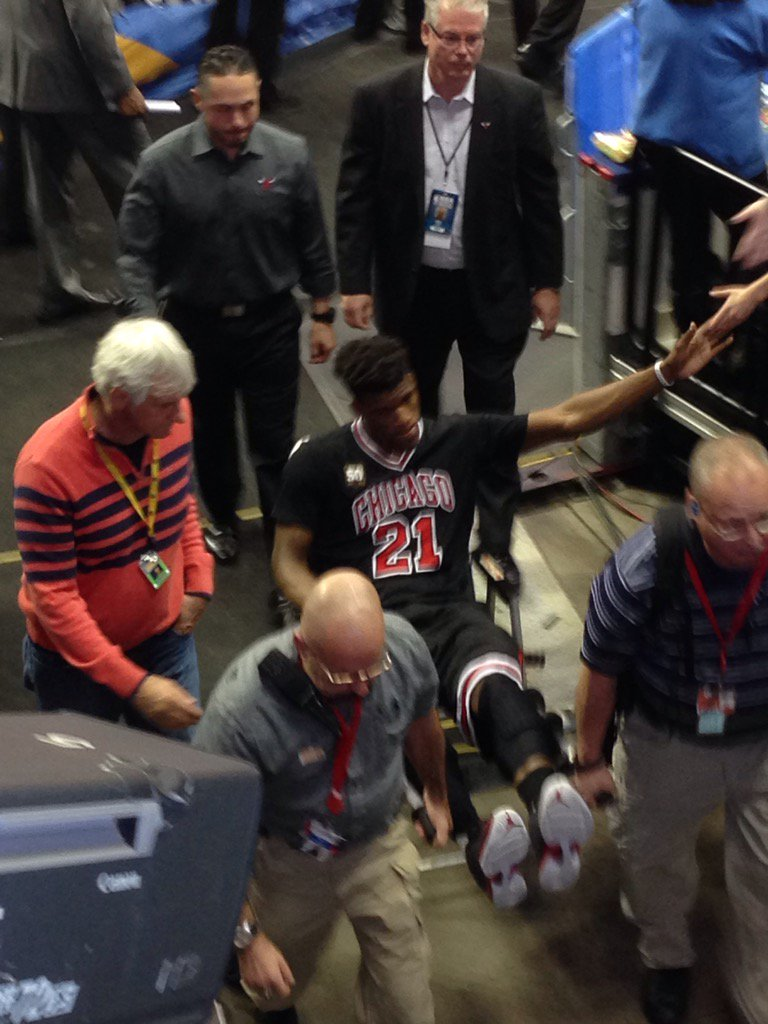 Here's Jimmy Butler being taken off the court with an apparent left knee injury. Bulls