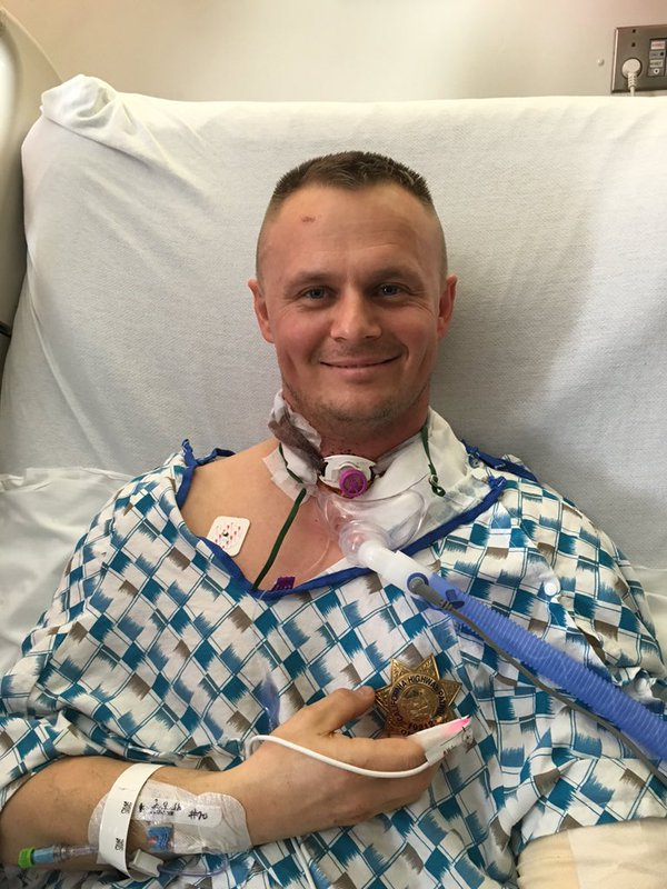 CHP photo of Officer Sirenko getting badge back & recovering in hospital after SF stabbing speedyrecovery