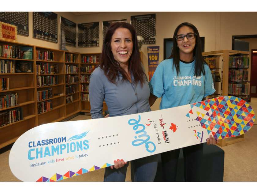 Paralympian snowborder presented with new graphic design for snowboard from Calgary student.