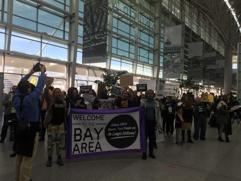 Every few feet the group stops to welcome people to the Bay Area and share their message including victims' names
