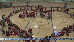 Students, teachers form giant heart for AmericanHeartMonth