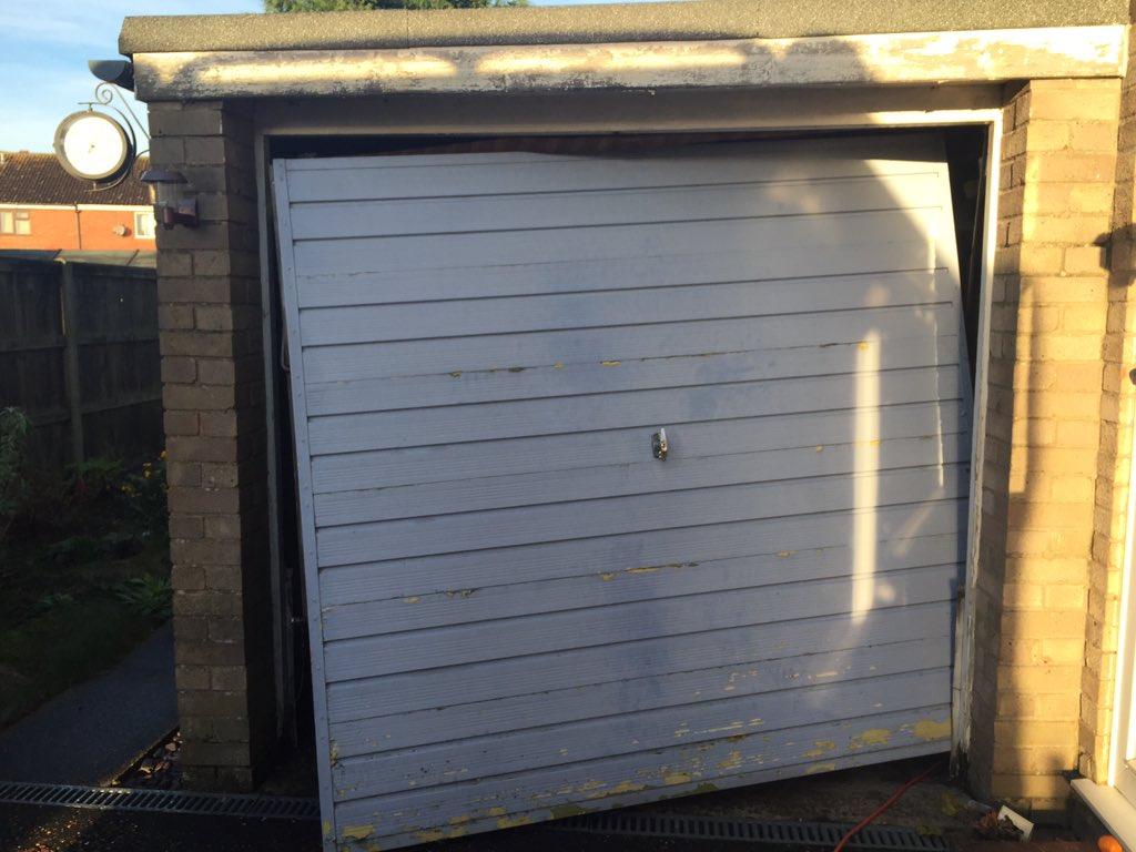 Garage door man ylgdmltd twitter for Man door in garage door