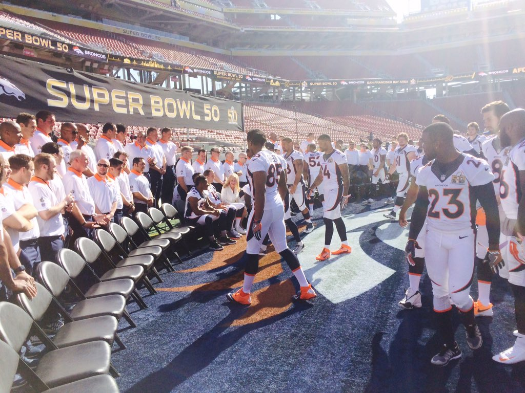 Players and coaches lining up for official Super Bowl 50 team picture.