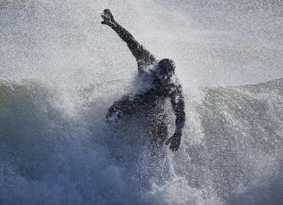 With wetsuits and plenty of grit, winter surfers revel in the beauty of storm-powered waves
