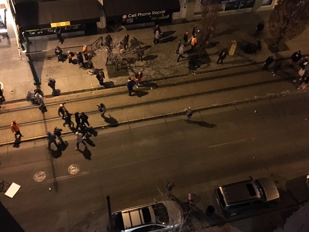 Crowd throwing garbage cans & getting rowdy near 16 & Champa. Denver