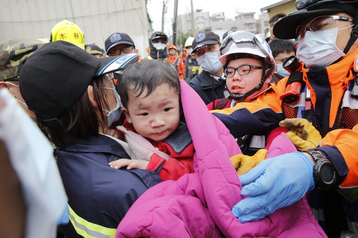 Survivors still being pulled from the rubble of a collapsed building in Taiwan after quake.
