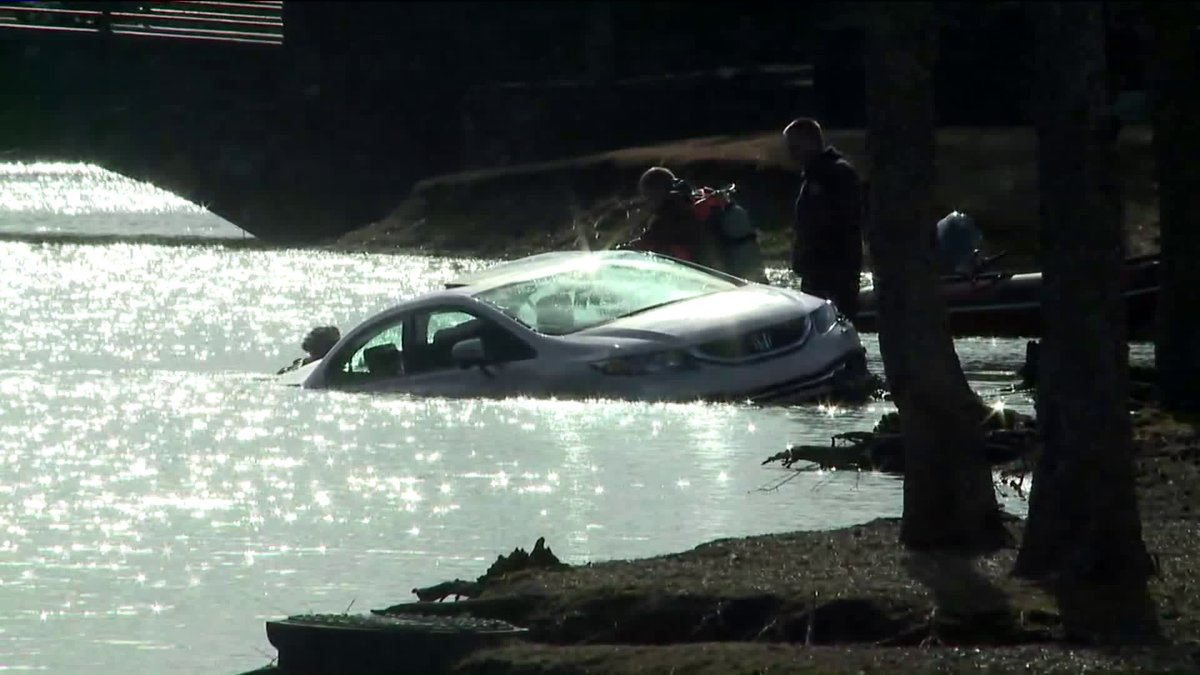 Crews pulling car from Memphis apartment complex lake. Not clear if anyone inside