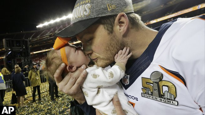 Broncos players celebrate with their families after SB50