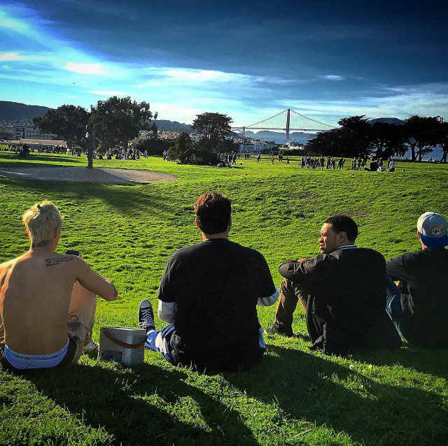 A shirtless Justin Bieber cavorts in the San Francisco grass