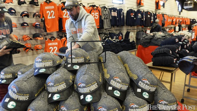 Grey locker room T-shirts and hats, like those worn by Broncos players, are hot items
