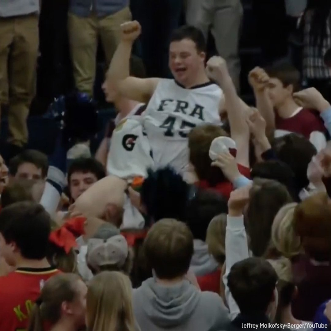Students rush the court after student with Down syndrome hits game-winning shot