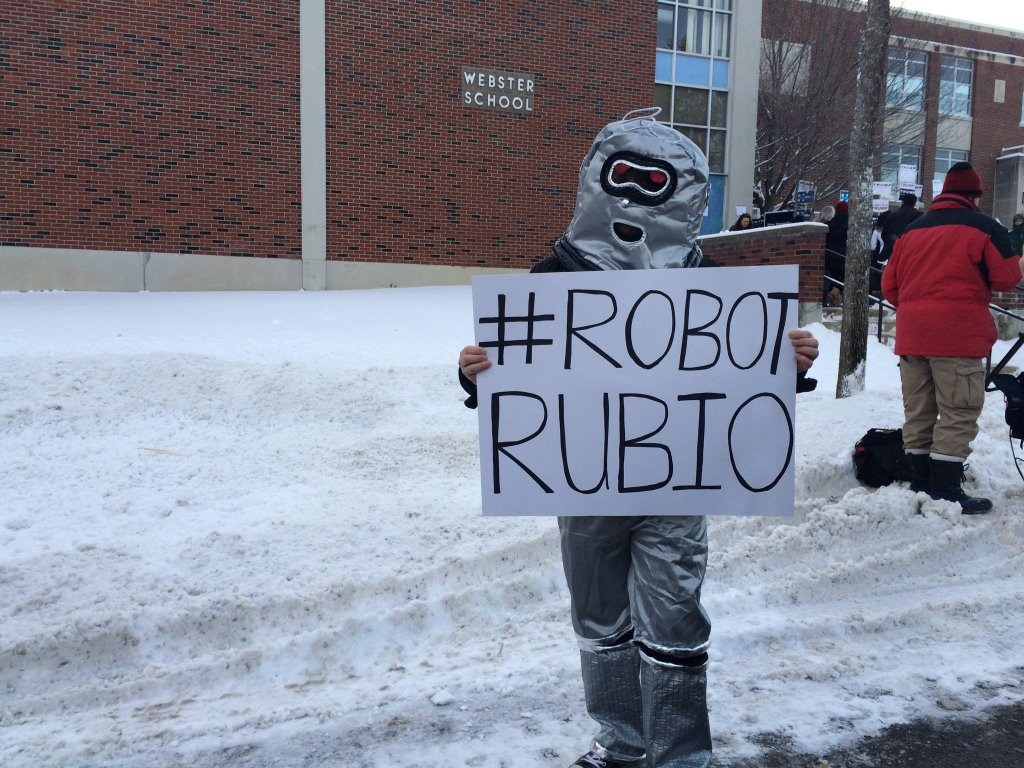 Men in robot costumes try to swarm Marco Rubio in Manchester