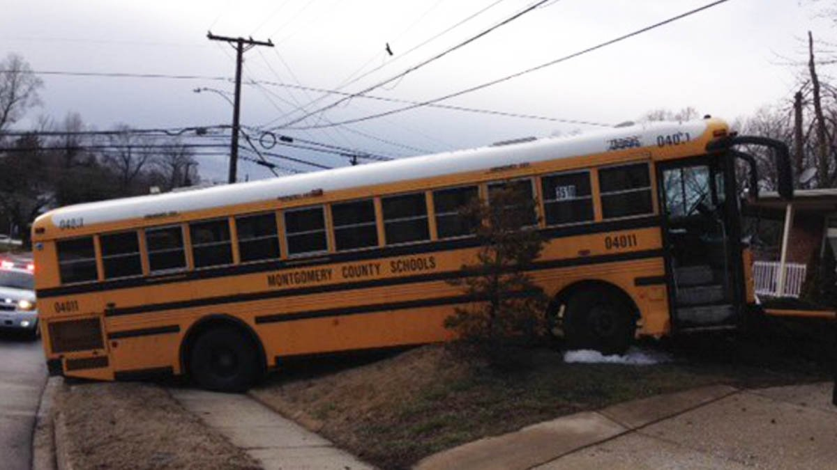 DEVELOPING: Montgomery County school bus crashes onto front lawn in Wheaton