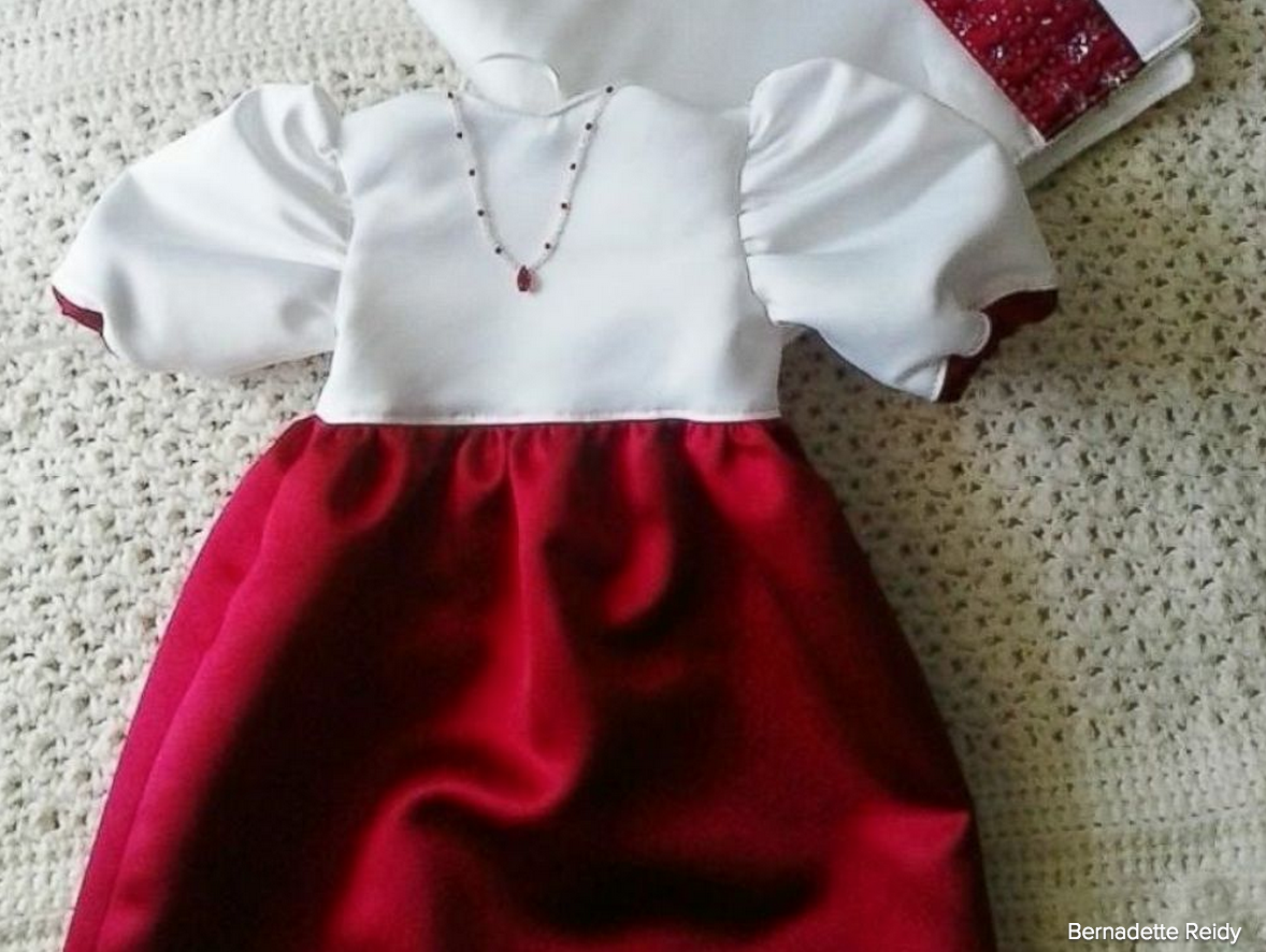 Volunteers create burial gowns for babies from wedding dresses to ...