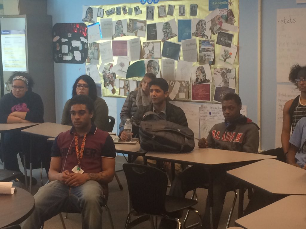 Cesar Chavez's grandson Anthony sits with Hinkley HS students talking about non-violence. 9news