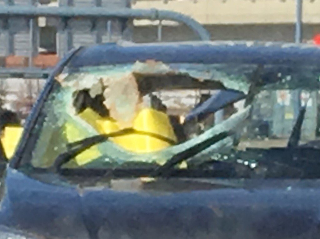 Car struck by airborne manhole cover end if O'Neill Tunnel SB fatal to driver. Mirror shot backwards wcvb boston