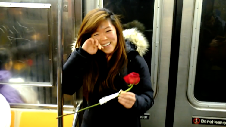 Watch an adorable video of unsuspecting subway riders receiving roses