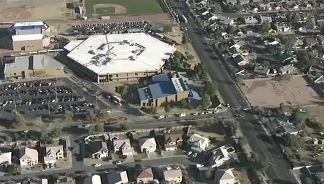 Police: 2 students, both 15-year-old girls, killed in shooting at Phoenix-area high school.