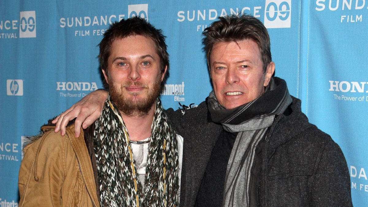 David Bowie's son announces wife is pregnant one month after dad's death -->