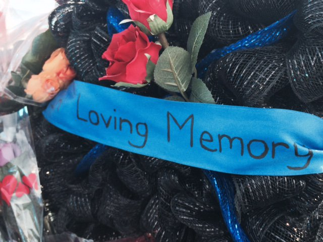 Steady stream of mourners leave tributes for slain deputies