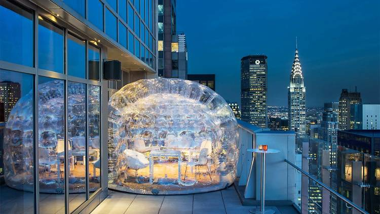 Party in two bubbles on this skyscraper's rooftop bar