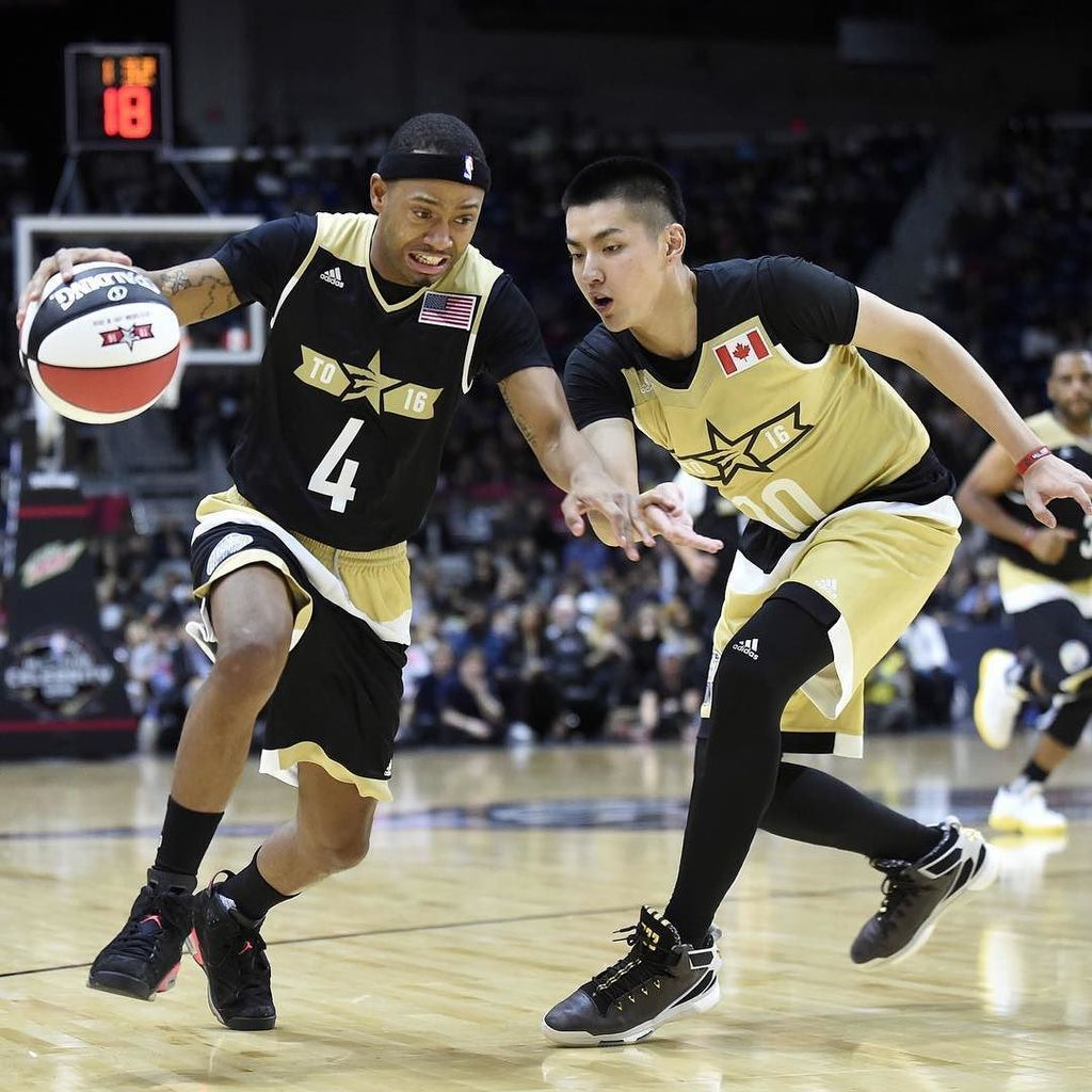 NBAAllStarTO Terrence Jenkins drives past Kris Wu during the All-Star celebrity basketbal…