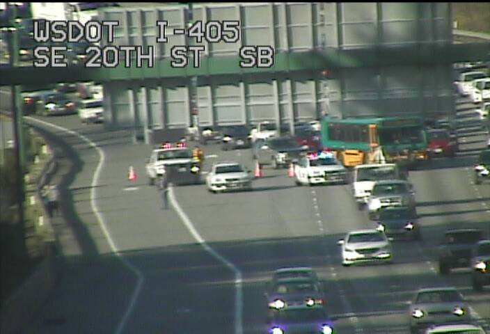 SB I-405 before I-90, an incident is blocking 3 right lanes.