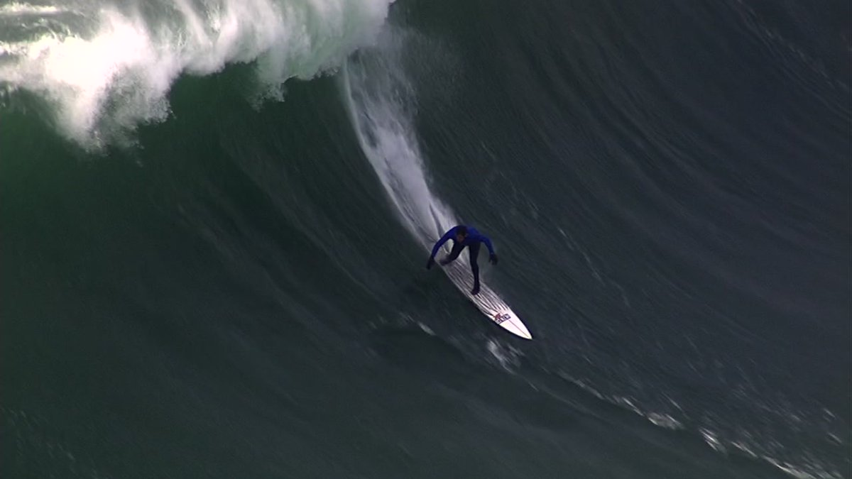 Surfers ride giant waves in the Titans of MavericksSurf competition