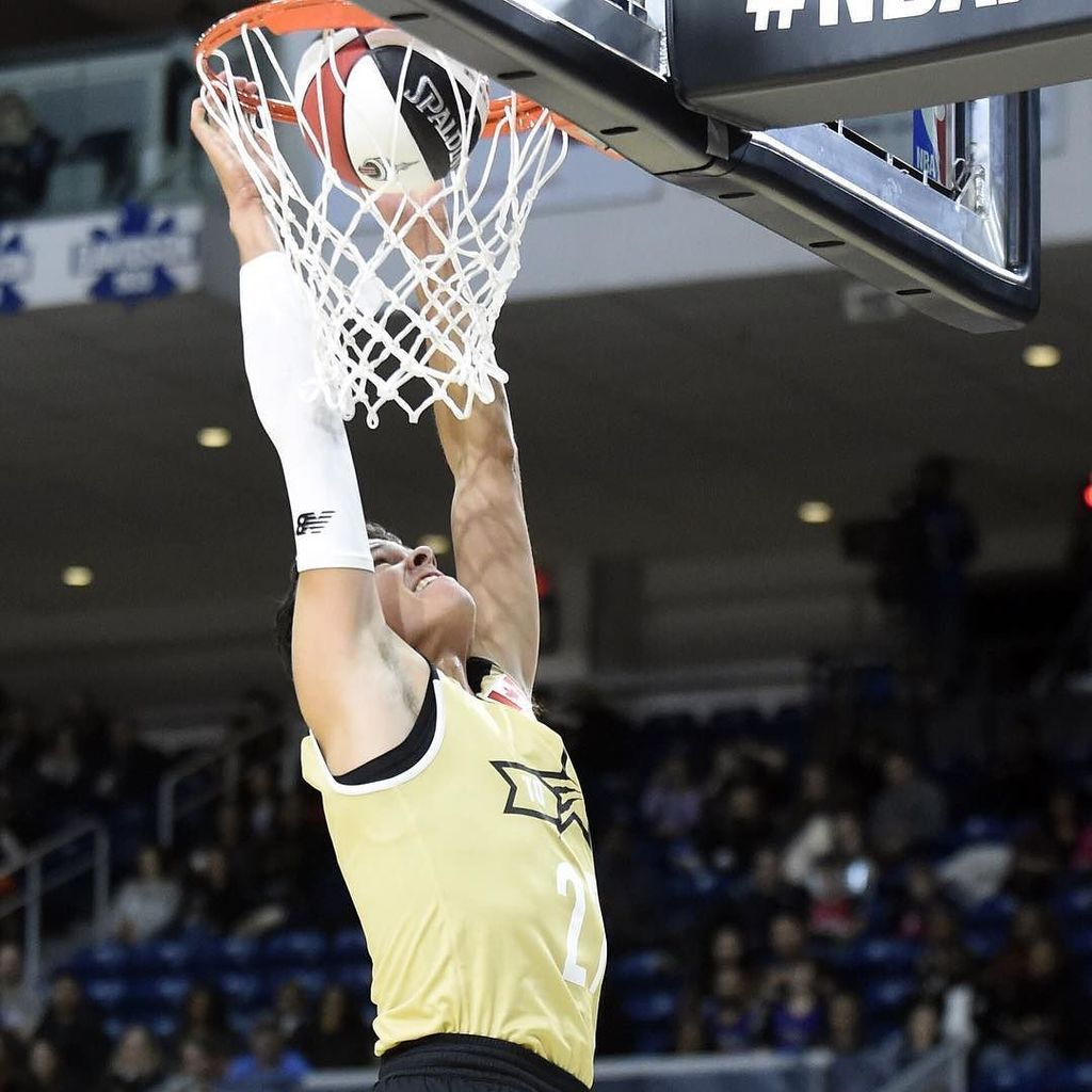 Canada player Milos Raonic dunks during the All-Star celebrity basketball game at Ricoh Co…