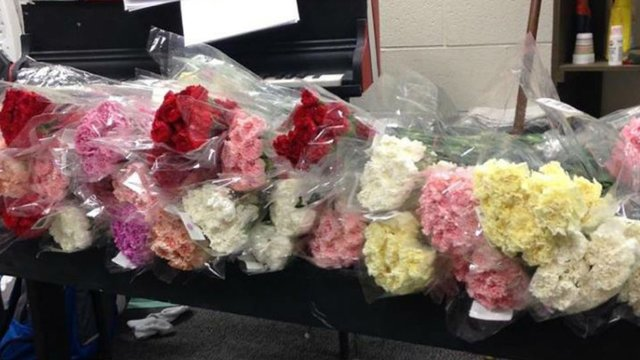 What a gentleman. Student buys a flower for every girl in his entire high school!