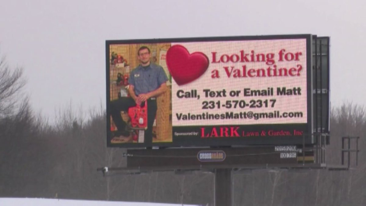 Coworkers seek dates for Michigan man.. by plastering him on a billboard