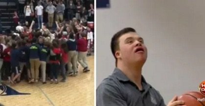 Students rush court when team manager with Down syndrome scores 3-pointer during the game