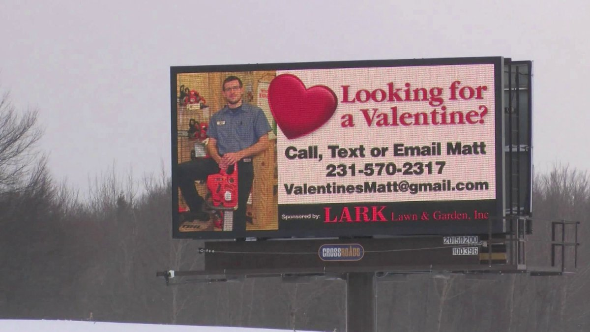 Coworkers surprise single man with billboard