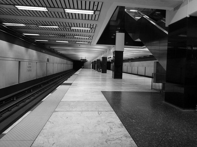 A woman died after trying to jump between levels at Civic Center BART Saturday night