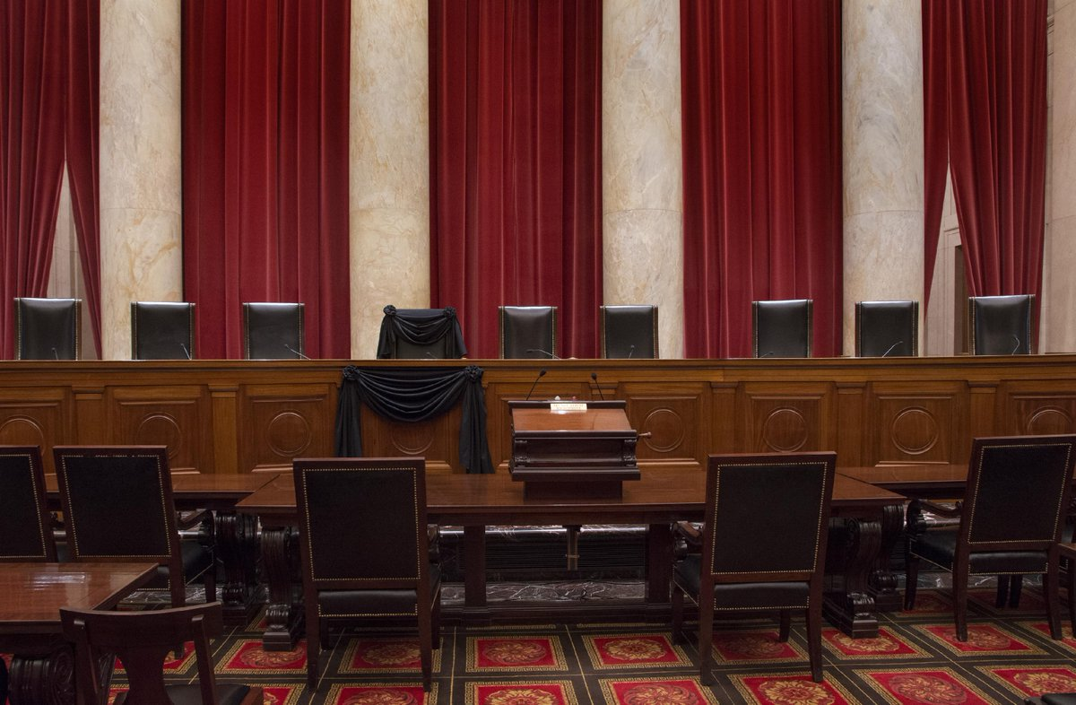 A poignant image: Justice Scalia's seat on the bench, now draped in black cloth. https://t.co/mwsBcyVgSI