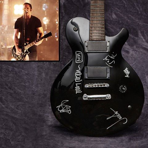 Bid to MEET @trent_reznor in LA and get this Signed Guitar, Played & Destroyed in Concert! https://t.co/TMKFKiadBX https://t.co/uWOtlDTz5d