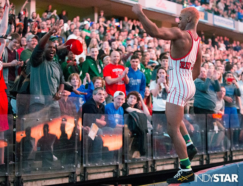 Chad Red, of New Palestine HS jumps on a wall to acknowledge fans after finishing his high school career undefeated https://t.co/SQnElf6txM