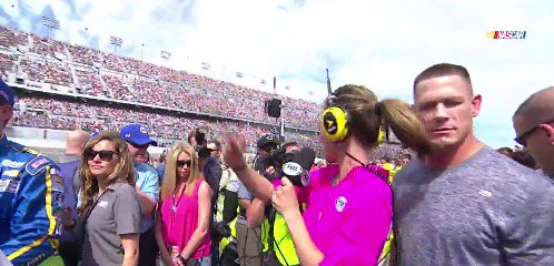 VIDEO: John Cena gets slapped in the face by reporter's ponytail at #DAYTONA500 https://t.co/r5U09aUAUo https://t.co/U45R4IBwwT