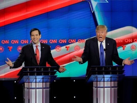 The Debate in A Photo.  Rubio slays Trump and smiles while he's doing it.  #GOPDebate https://t.co/vW7cbFlWnc