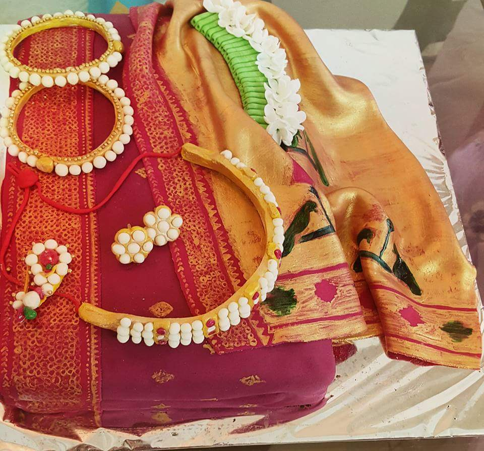 ... cake With beautiful Kolhapuri jewellery https://t.co/UYyPC4F33D