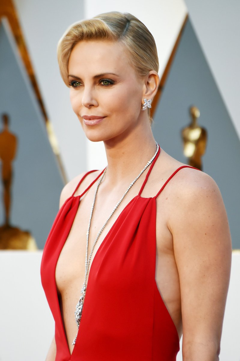 Charlize Theron looked elegant in a red #Diorcouture dress at the 88th annual Academy Awards. #StarsinDior #Oscars