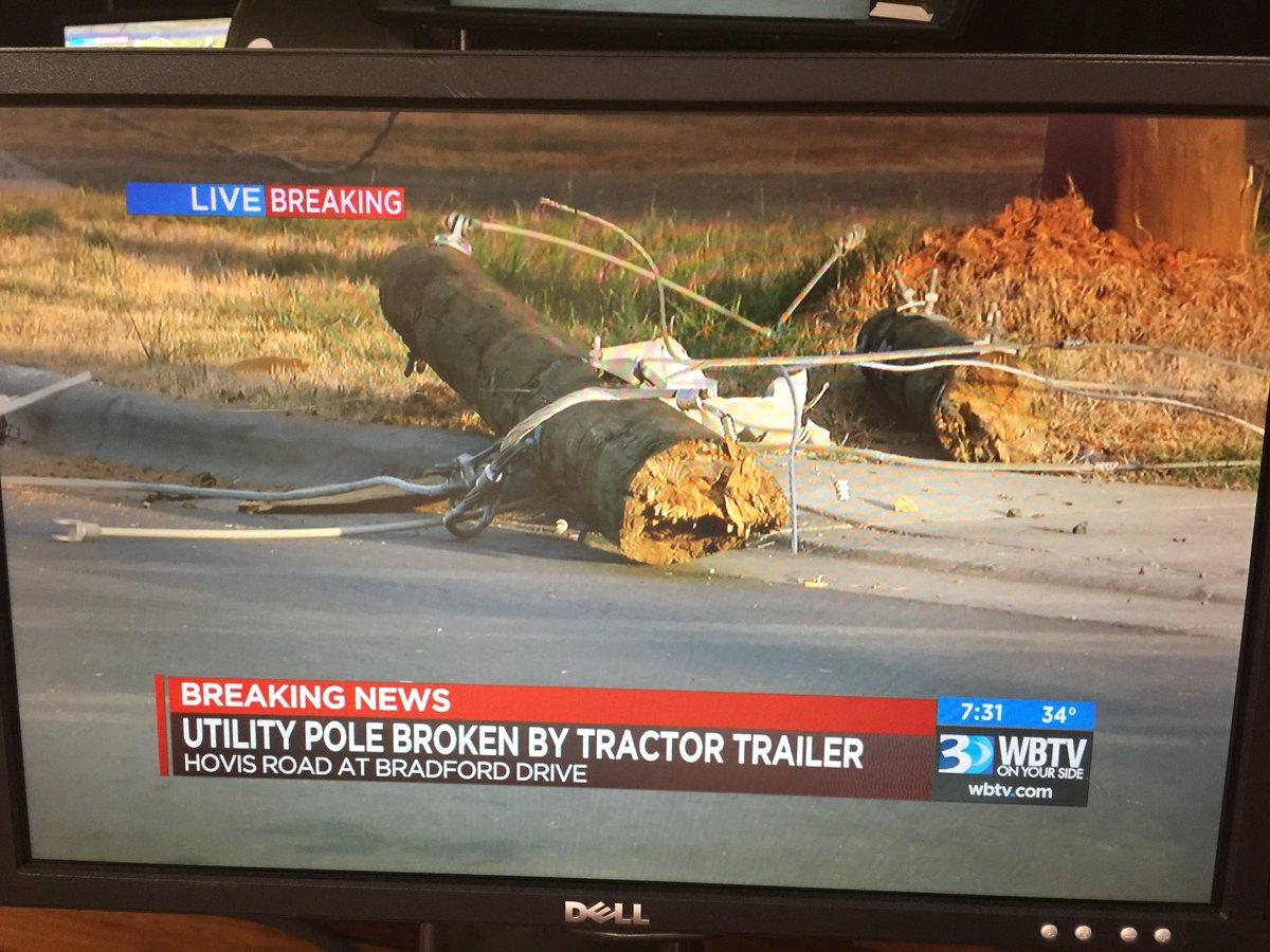 Live: semi struck this pole, still on ground  road blocked