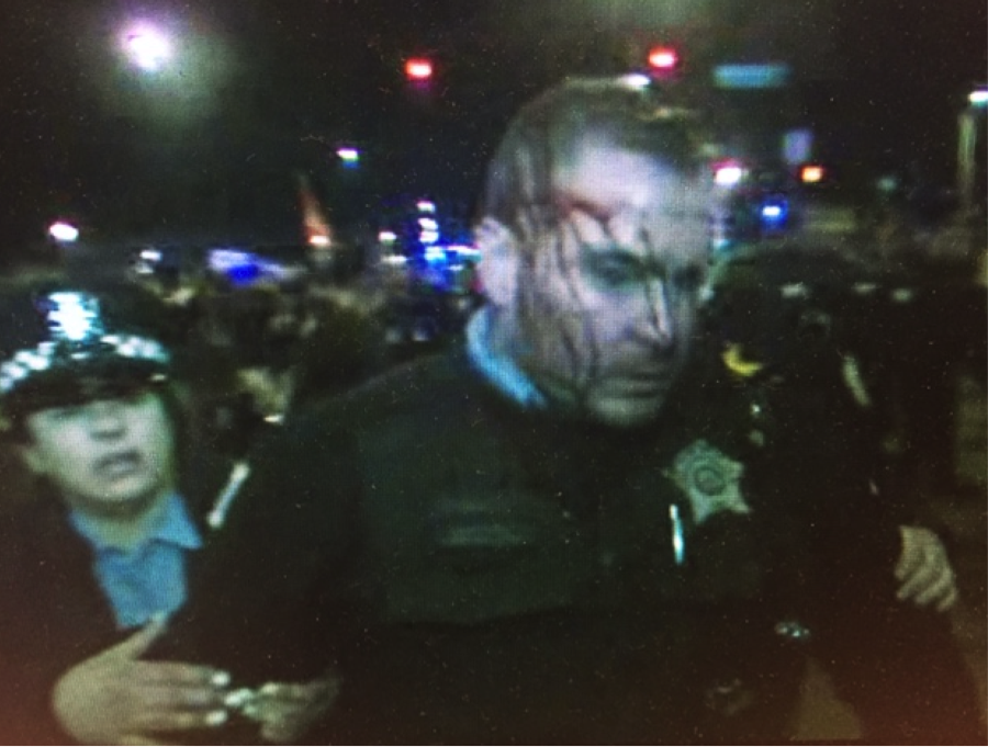 Chicago police officer led away outside #UICpavilion where Donald #Trump postponed his appearance tonight. #CPD