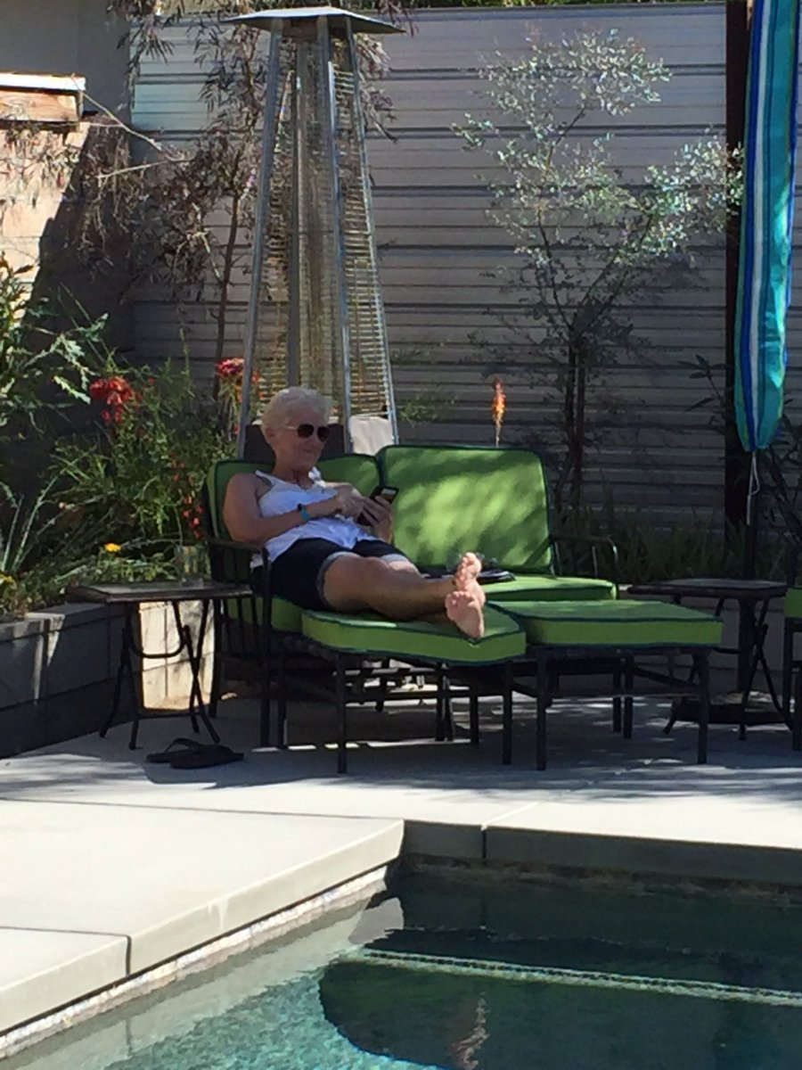 """We used to work in an office. Now @sandramc59 sits by my pool and tells me she's """"still working"""". #WhatALife ❤️ https://t.co/0ZrgNjK4aU"""