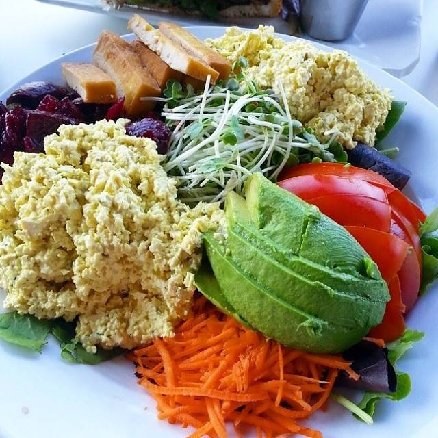 """""""The Salad"""" - Greens w/tofu egg salad, roasted beets, edamame salad, carrot, tomato, avocado, baked tofu & sprouts. https://t.co/dfygcQgJAw"""