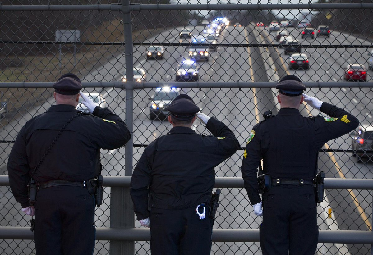 Officers salute as trooper thomas clardy's body passes on ...
