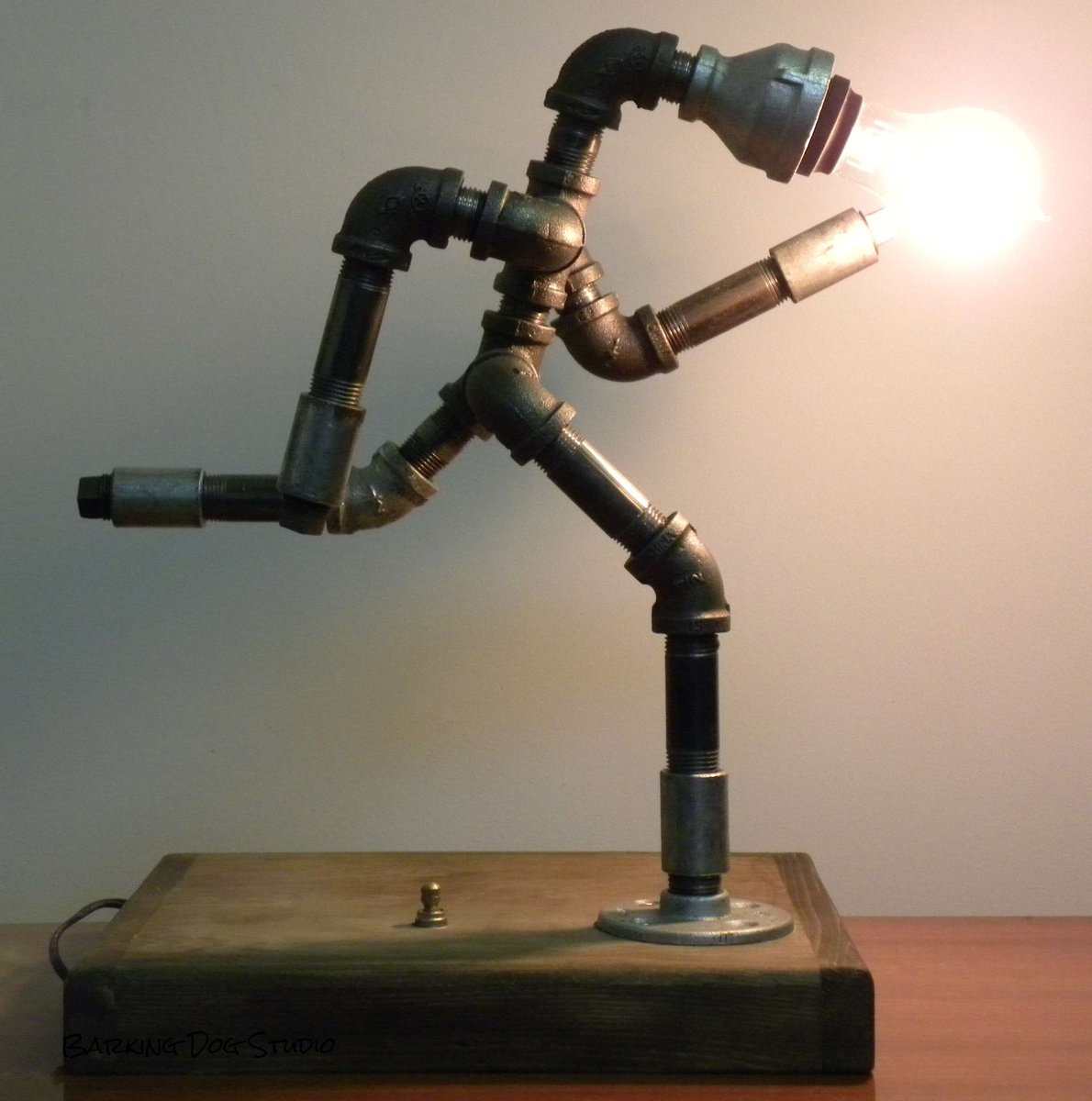 Barking dog studio on twitter running man lamp with for Pipe lamp plans